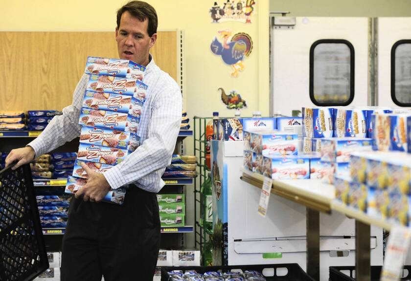 Hostess will close 33 bakeries, 565 distribution centers and 570 bakery outlet stores nationwide. Above, Scott Hubbard of Chico, Calif., stocks up on Zingers.