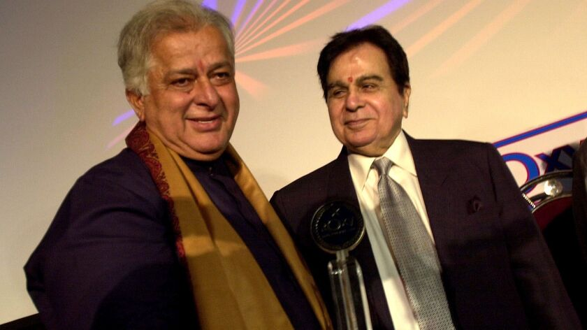 Shashi Kapoor, left, appears with fellow Bollywood actor Dilip Kumar in 2005 at a premiere in Mumbai.