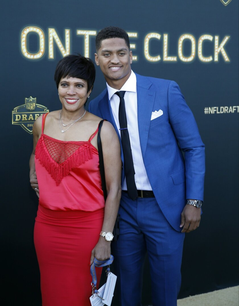 Wake Forest defensive back Kevin Johnson poses for photos his mother Judy Johnson, upon arriving for the first round of the 2015 NFL Football Draft at the Auditorium Theater of Roosevelt University, Thursday, April 30, 2015, in Chicago. (AP Photo/Charles Rex Arbogast)