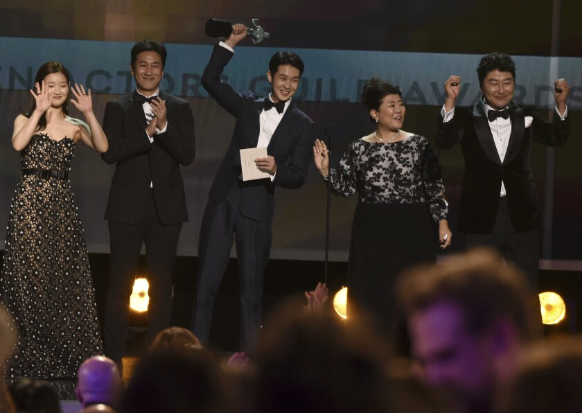 """Park So Dam, from left, Lee Sun Kyun, Choi Woo Shik, Lee Jung Eun and Song Kang Ho accept the award for performance by a cast in a motion picture for """"Parasite"""" at the 26th Screen Actors Guild Awards at the Shrine Auditorium in Los Angeles on Sunday."""