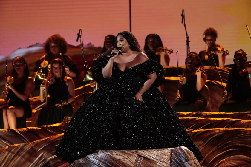Lizzo performs at the 62nd Grammy Awards