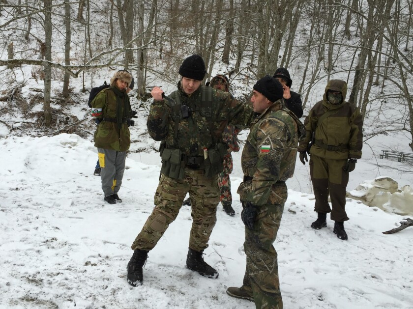 An instructor demonstrates use of a hunting knife to volunteers who aim to stop migrants from crossing into Bulgaria from Turkey.