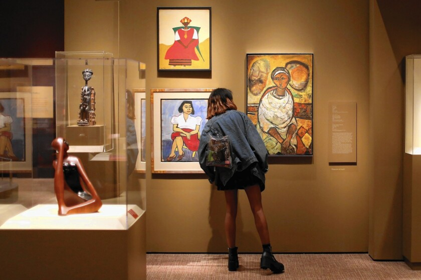 "A visitor pauses while looking at the ""Conversations: African and African American Artworks in Dialogue"" exhibit at the Smithsonian Museum of African Art on the National Mall on July 15, 2015 in Washington, DC."