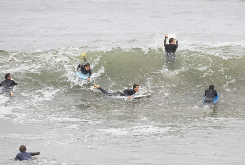 Surfers and boogie boarders angle for position at the Wedge in Newport Beach on Thursday.