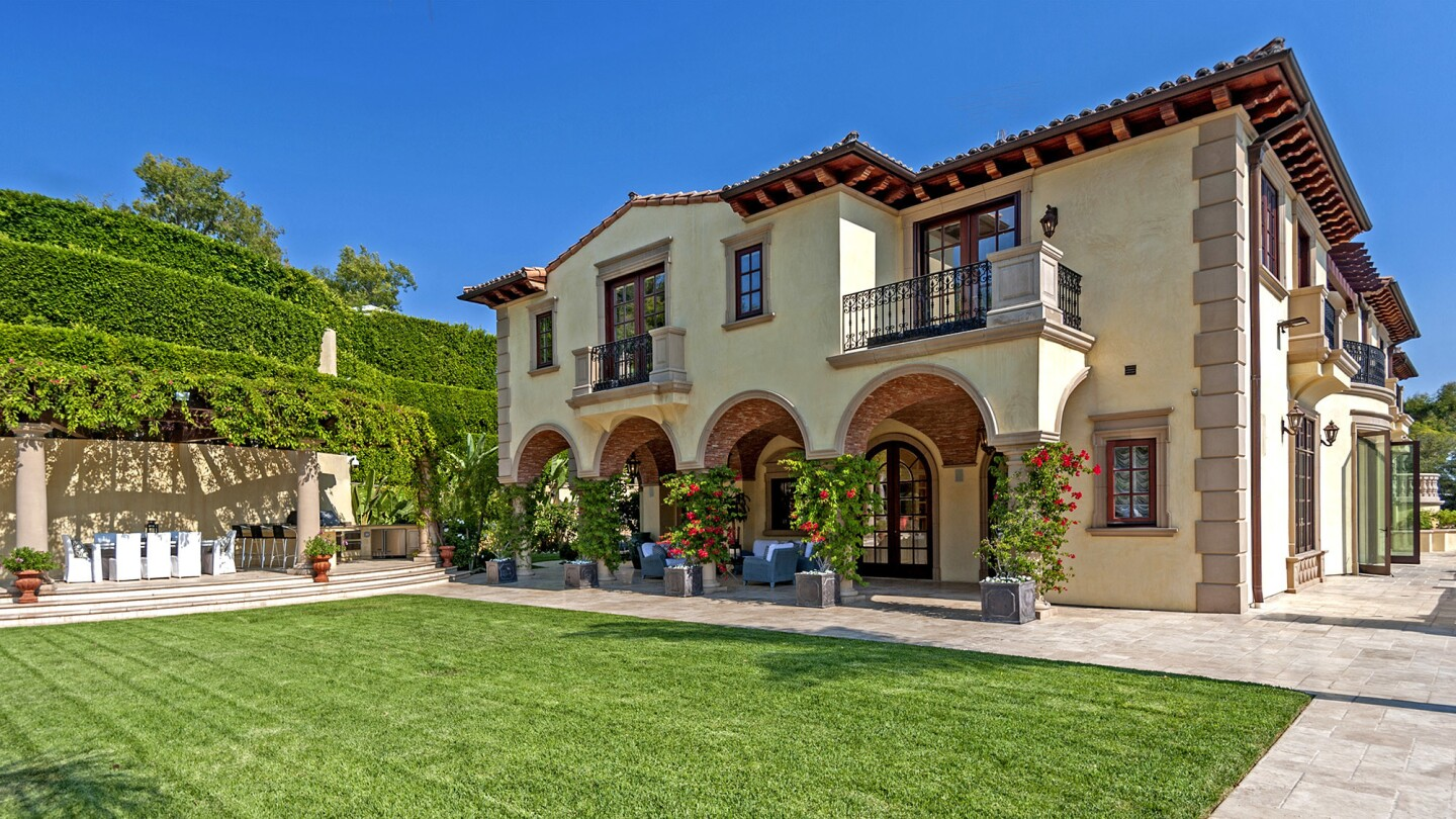 The multilevel mansion sits on slightly more than an acre on grounds adjacent to what was once the legendary Pickfair estate.