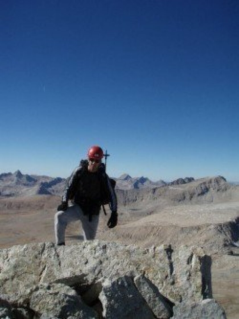 Jeff Hanson steps onto the Mount Tyndall summit ridge for the KTS 10th.
