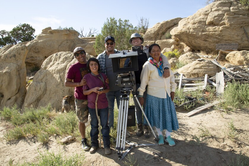 """This Aug. 17, 2019, photo shows, from left, Lyndell Chee, Micah Chee, Rich Pring, Christopher Nataanii Cegielski and Colleen Biakeddy during production of Cegielski's New Balance spec called """"For Any Run"""" in Pinon, Ariz.The video is a product of the Commercial Directors Diversity Program, an organization that provides guidance, exposure and tools for minority directors who hope to work in the industry. (Courtesy of Alisa Banks via The AP)"""