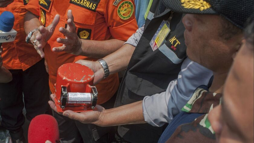 A member of Indonesia's National Transportation Safety Committee holds the flight data recorder from the crashed Lion Air jet Nov. 1.