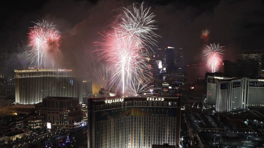 Fireworks explode over the Las Vegas Strip during a New Year's Eve celebration Sunday, Jan. 1, 2017,