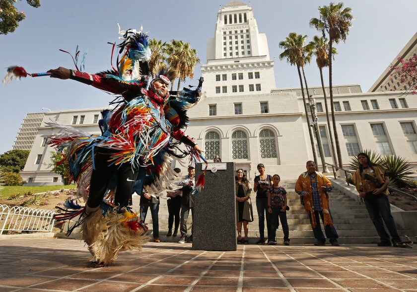 Kenneth Thomas Shirley, a Navajo Nation champion dancer and the CEO of Indigenous Enterprise, performs at Los Angeles City Hall in advance of the city's Indigenous People's Day celebration.