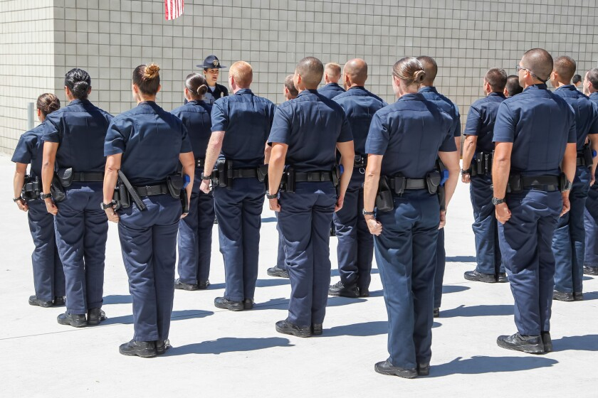 Police officer Mariam Sadri, who is a recruit training officer, leads recruits from the 112th Regional Academy in June 2017.