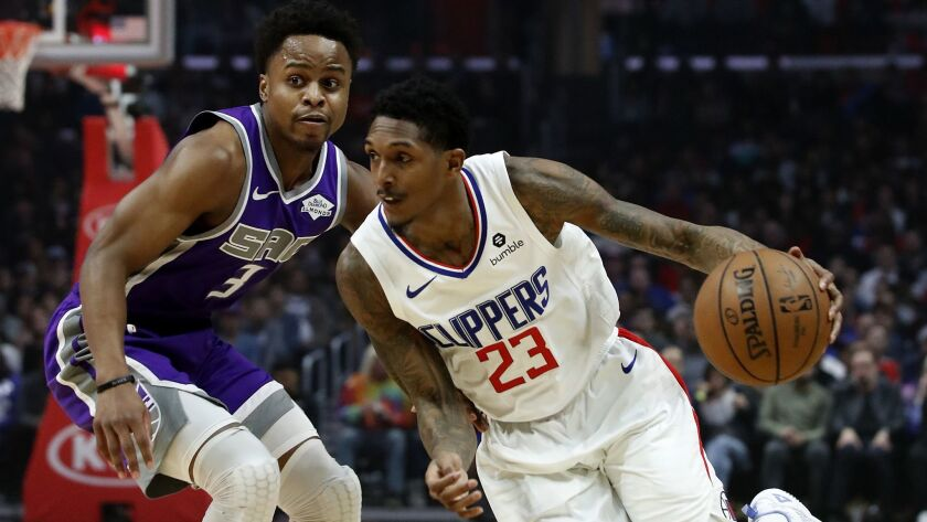 LOS ANGELES, CALIF. - DEC. 8, 2018. Clippers guard Lou Willimas drives to the basketbagainst Kings