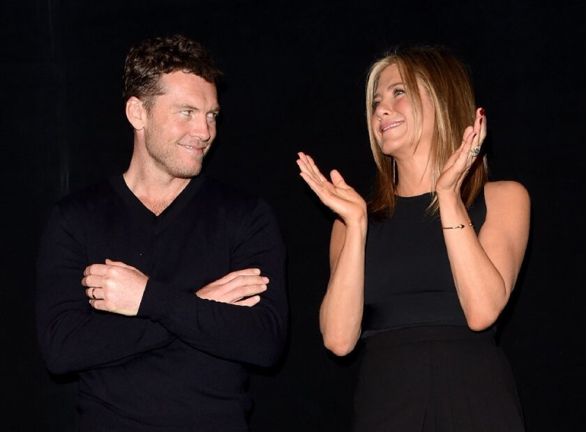 "Sam Worthington and Jennifer Aniston onstage at the Toronto premiere of their new drama, ""Cake."""