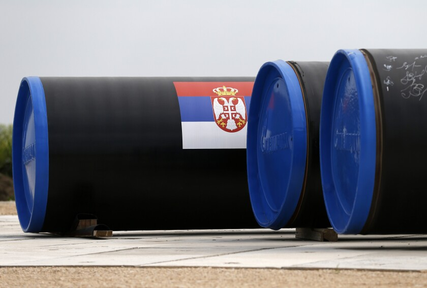 FILE - In this Friday, June 13, 2014, file photo, a Serbian flag is seen on a gas pipe on the first section of the Gazprom South Stream natural gas pipeline near the village of Sajkas, 80 kilometers (50 miles) north of Belgrade, Serbia. Defying U.S. calls to reduce its dependency on energy supplies from Russia, Serbia has on Friday, Jan. 1, 2021 officially launched a new gas link that will bring additional Russian gas to the Balkan country via Bulgaria and Turkey. (AP Photo/Darko Vojinovic, File)
