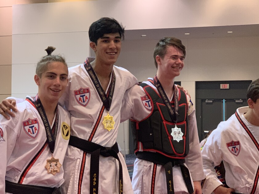 Andrew Heiati, center, won his second sparring gold medal at the ATA World Championships.
