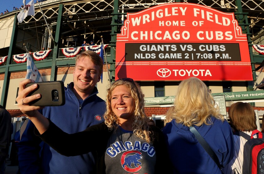 Fans outside Chicago's Wrigley Field before the Oct. 8 playoff game between the Cubs and San Francisco Giants.