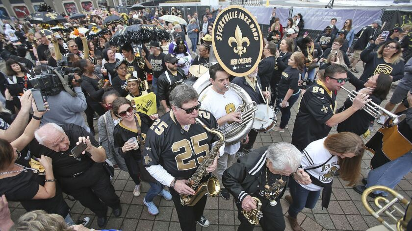 The Storyville Jazz Band leads a jazz funeral for the Saints' season on Feb. 3.