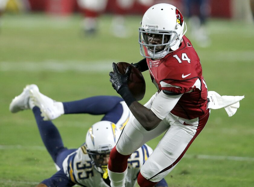 FILE - In this Saturday, Aug. 22, 2015 file photo, Arizona Cardinals wide receiver J.J. Nelson (14) pulls in a pass as San Diego Chargers cornerback Richard Crawford (35) defends during the first half of an NFL preseason football game in Glendale, Ariz. Nelson, a fifth-round draft choice in 2015, h