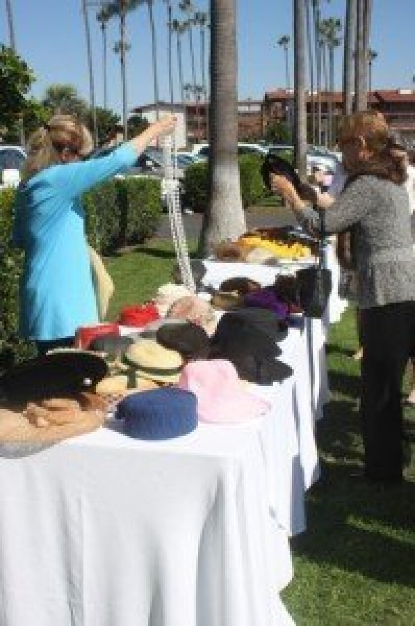 Terre Edwards and Marian Warwick pick out period attire for their photo.