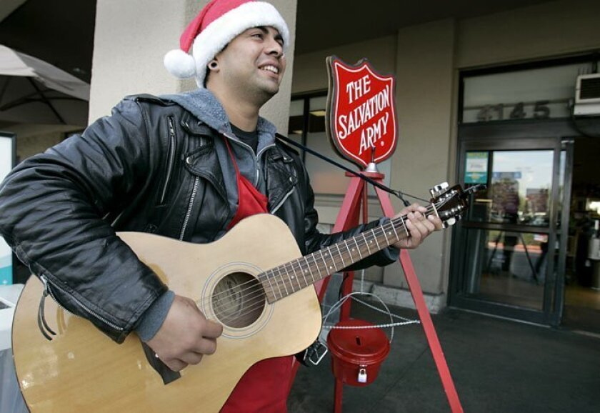 Salvation Army bell ringer George Bernal added a fresh twist to his job this year, strumming his guitar more than ringing the bell outside the Vons on 30th Street in North Park. Donations are down this year for many reasons, just when the need for assistance is greater. Maj. Ron Wildman said the bell-ringing program brought in about $110,000 last year. While the charity hopes to make $16,000 more than that, it estimates that it will be lucky to make $90,000 total this year.