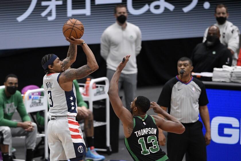 Washington Wizards guard Bradley Beal (3) shoots against Boston Celtics forward Tristan Thompson (13) during the first half of an NBA basketball game, Sunday, Feb. 14, 2021, in Washington. (AP Photo/Nick Wass)