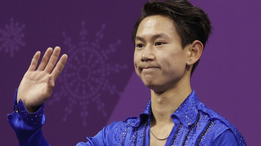 Denis Ten reacts as his score is posted after his performance in the men's short program at the 2018 Winter Olympics in Gangneung, South Korea.