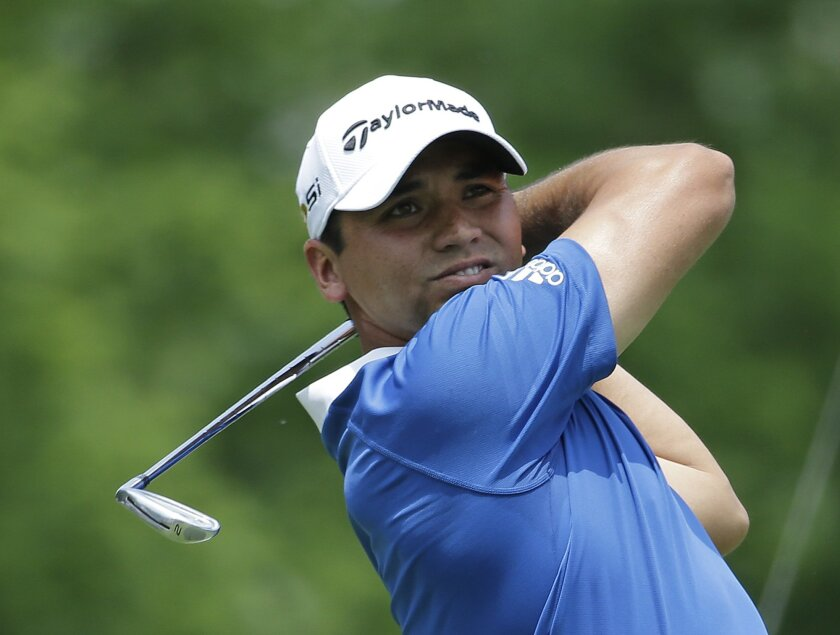 Jason Day, of Australia, watches his tee shot on the third hole during the first round of the Memorial golf tournament, Thursday, June 2, 2016, in Dublin, Ohio. (AP Photo/Darron Cummings)
