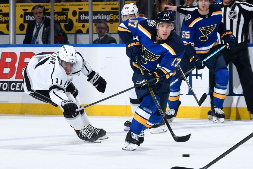 St. Louis Blues forward Jaden Schwartz passes the puck in front of Kings forward Anze Kopitar during the Kings' 5-2 loss Thursday.