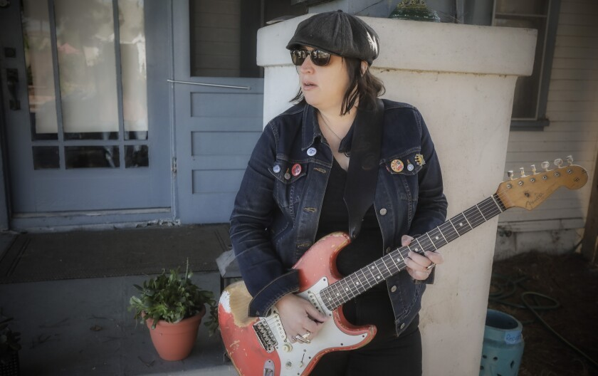 During the pandemic, guitarist Laura Chavez has performed music on this porch in Normal Heights.