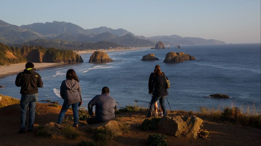 CANNON BEACH, ORE. -- SATURDAY, SEPTEMBER 1, 2018: Tourists take in the view from Ecola State Park i