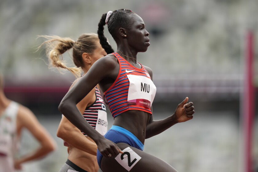 Athing Mu wins a heat in the women's 800 meters at the Tokyo Olympics on Friday.