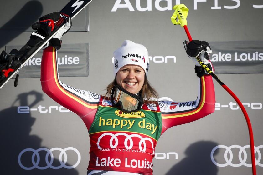 Germany's Viktoria Rebensburg celebrates winning the women's World Cup super-G ski race in Lake Louise, Alberta, Sunday, Dec. 8, 2019. (Jeff McIntosh/The Canadian Press via AP)