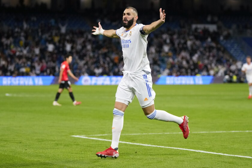 Real Madrid's Karim Benzema celebrates after scoring his team's fifth goal during a Spanish La Liga soccer match between Real Madrid and Mallorca at the Bernabeu stadium in Madrid, Spain, Wednesday, Sept. 22, 2021. (AP Photo/Manu Fernandez)