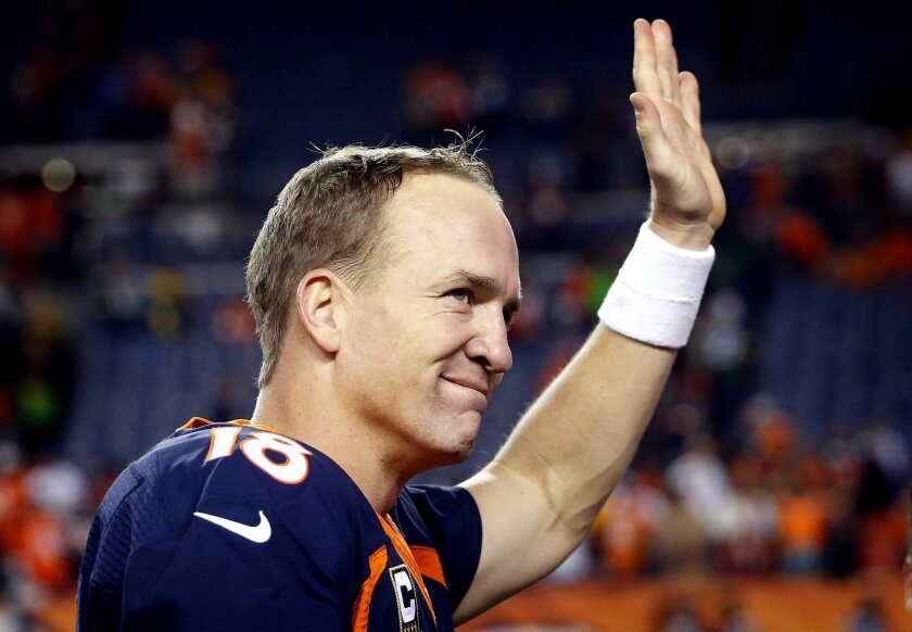 Denver Broncos quarterback Peyton Manning (18) waves after an NFL football game against the Green Bay Packers, Sunday, Nov. 1, 2015, in Denver. With the win, Manning tied Brett Favre with the most wins in NFL history by a starting quarterback with 186. The Broncos won 29-10 to improve to 7-0. (AP P