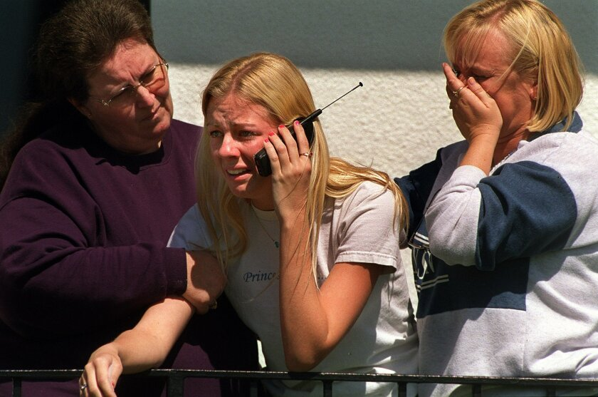 Parent of a Santana High School student, Linda Eyler of El Cajon, comforts Nicolle Aldrich, 17, center, and her mother, Terry Adams, right, as Nicolle finds out that four of her friends were injured in the shooting. (Published 03/06/2001)