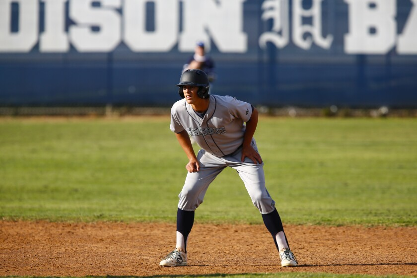 La Costa Canyon first baseman Spencer Jones leads off from second base during the sixth inning against Madison.