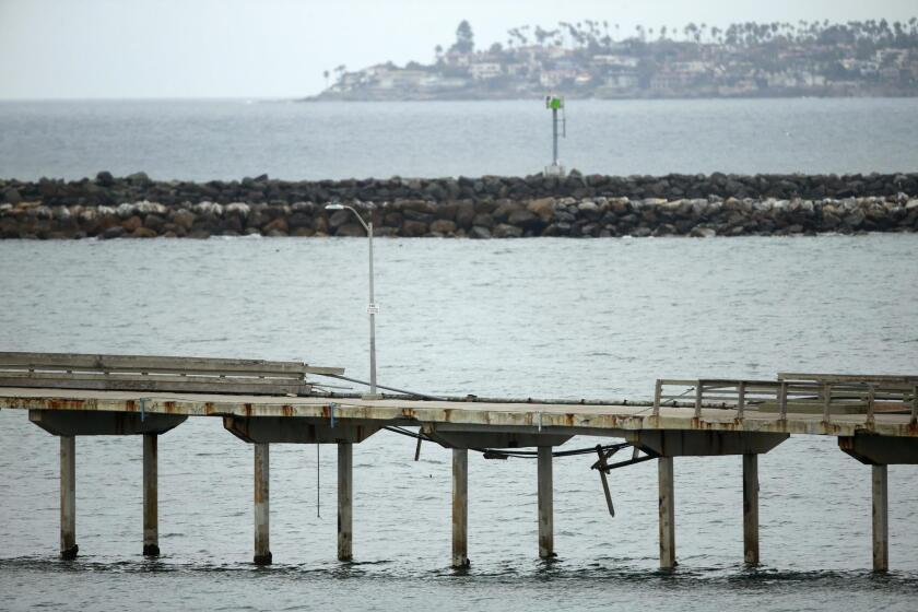 The OB Pier, shown here March 6, remains closed after damage is sustained during recent storms.