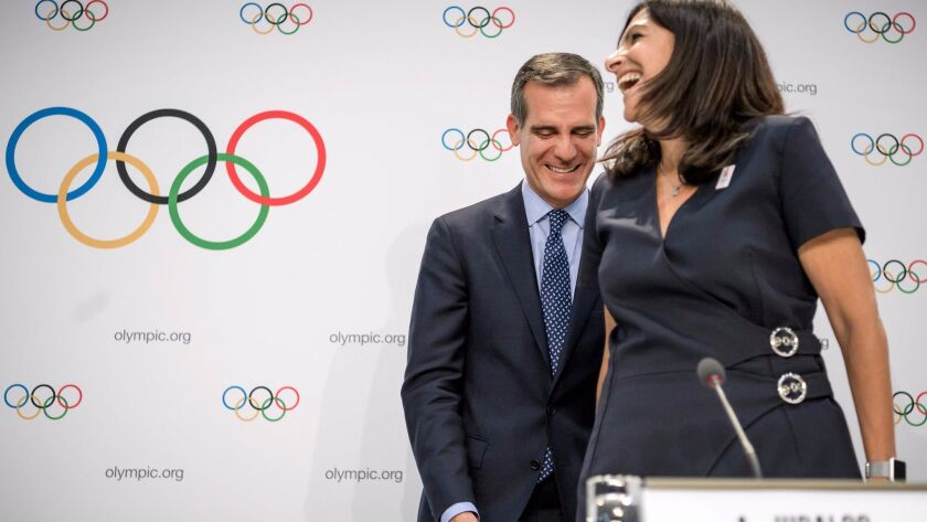 L.A. Mayor Eric Garcetti laughs with Anne Hidalgo, mayor of Paris, during a news conference followin