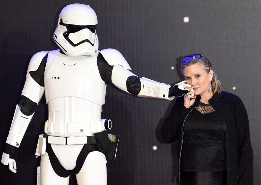 "Carrie Fisher poses next to a Stormtrooper at the European premiere of ""Star Wars: The Force""Awakens' in London."