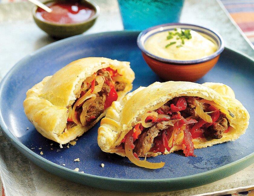 Ravioli-Shaped Pies with Stir-Fried Beef, Onions, and Peppers (Empanadas de Lomo Saltado).