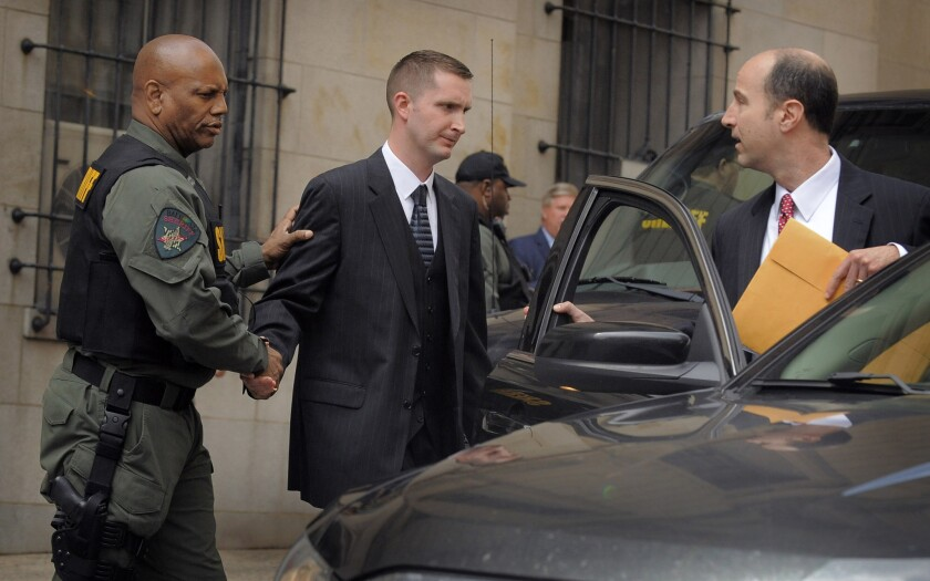 Baltimore Police Officer Edward Nero leaves the courthouse after he was acquitted of all charges.