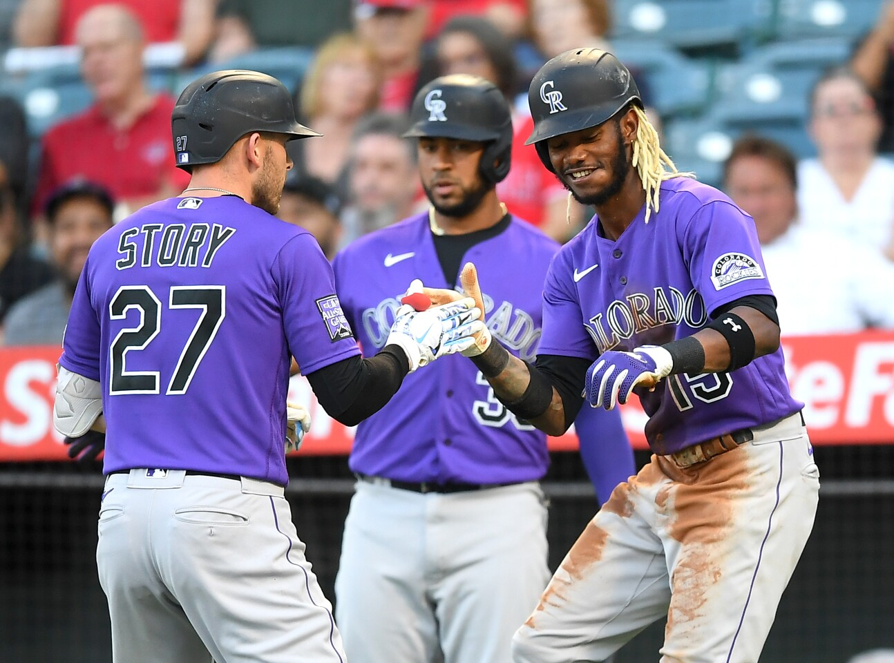 ANAHEIM, CA - JULY 28: Trevor Story #27 celebrates with Raimel Tapia #15 of the Colorado Rockies after hitting a two run home run in the first inning of the game against the Los Angeles Angels at Angel Stadium of Anaheim on July 28, 2021 in Anaheim, California. (Photo by Jayne Kamin-Oncea/Getty Images)