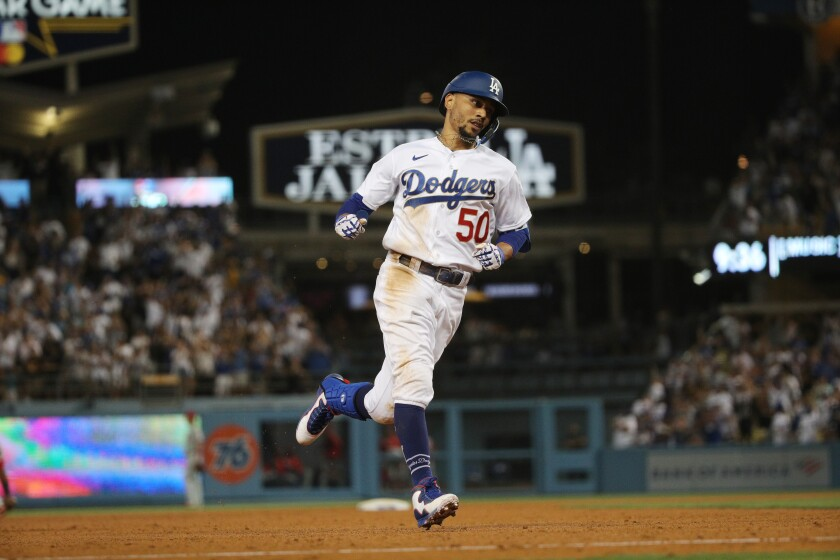 The Dodgers' Mookie Betts runs the bases after hitting a solo homer.