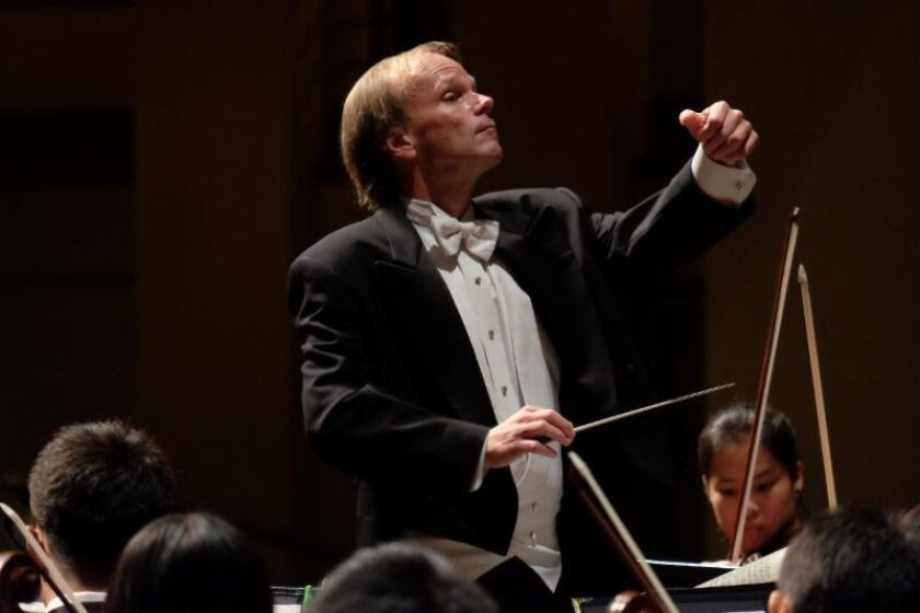 Music Director Jeff Edmons will lead 80 student musicians to China this summer, including eight Canyon Crest Academy students.