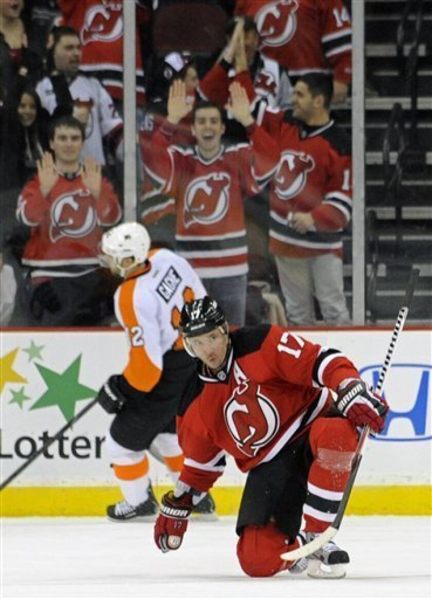 New Jersey Devils' Ilya Kovalchuk (17), of Russia, celebrates his short-handed goal as Philadelphia Flyers' Simon Gagne skates away during the first period of an NHL hockey game on Wednesday, March 13, 2013, in Newark, N.J. (AP Photo/Bill Kostroun)