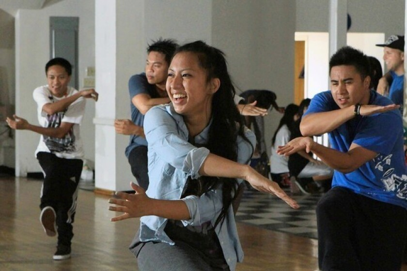 """Krystle Bueno, center, and other cast members rehearse """"BEauty."""""""