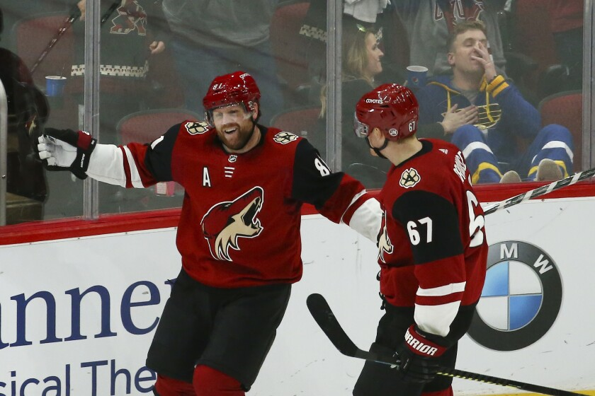 Arizona Coyotes right wing Phil Kessel (81) celebrates his goal against the St. Louis Blues with Coyotes left wing Lawson Crouse (67) during the third period of an NHL hockey game Tuesday, Dec. 31, 2019, in Glendale, Ariz. The Coyotes defeated the Blues 3-1. (AP Photo/Ross D. Franklin)