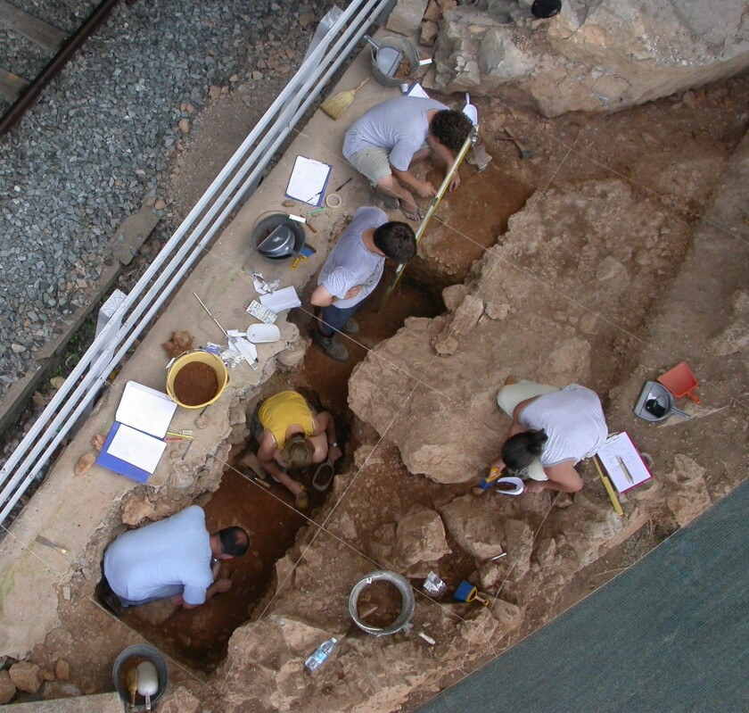 Archaeologists are shown excavating a Neanderthal shelter at Riparo Bombrini, in northwest Italy.