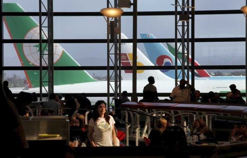 Planes from around the world line up at LAX's Tom Bradley International Terminal. The terminal's food court is a good hangout spot for long layovers. It has the nicest views, most food choices and comfy seating.