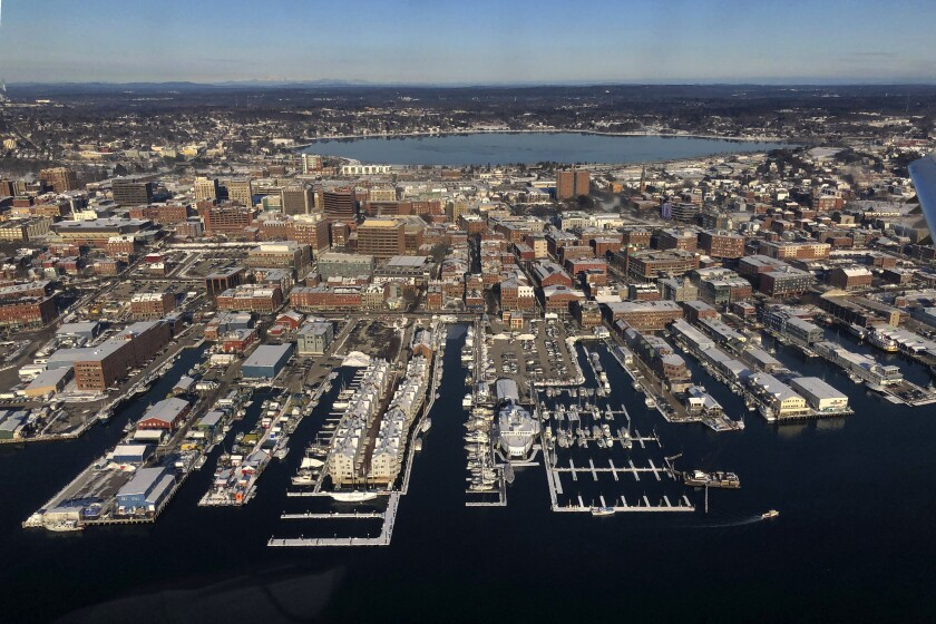 Trump's trade fights have heightened uncertainty for corporations. Above, the waterfront in Portland, Maine.